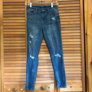 Medium wash ripped blue jeans